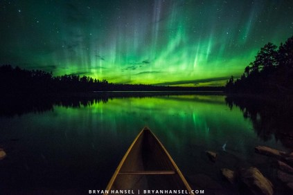 canoe under the northern lights