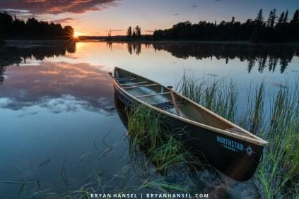 sunset on devil track over a canoe