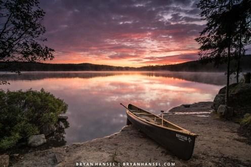 sunrise over a canoe in the BWCA