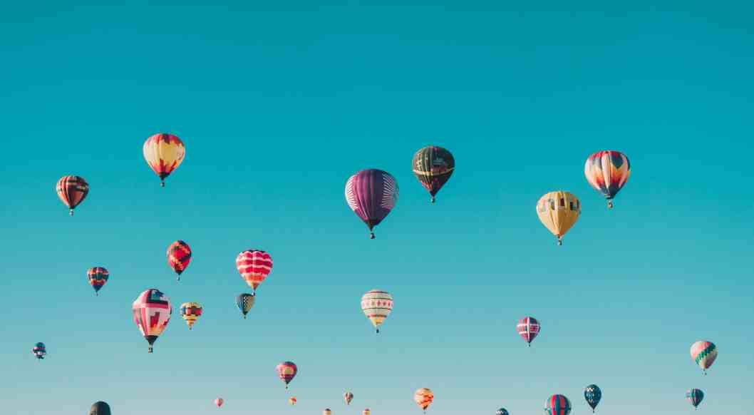 hot air balloons in a brilliant blue sky