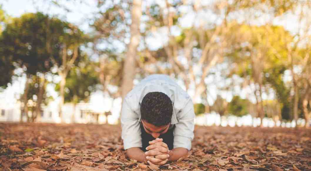 man praying with passion
