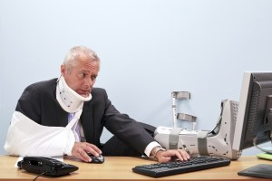 Loredo Injury Attorney Injured businessman working at his desk