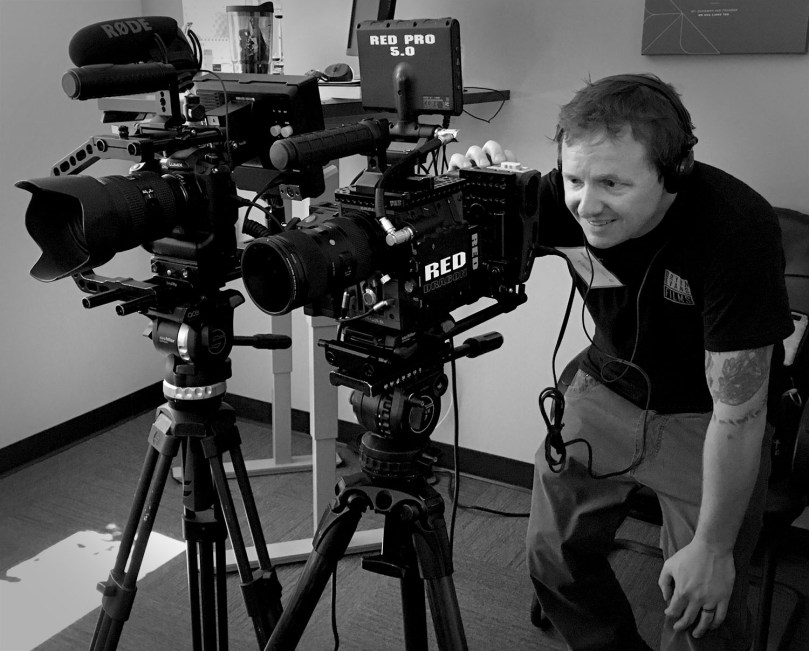 Bryon Evans setting up for two camera interview using RED Dragon & GH5.