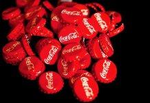Tappi di bottigliette Coca cola, foto di Couleur da Pixabay