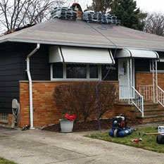 picture of a house with roofing and other general contractor work done to it by brightside restoration in medina ohio roofing