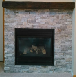 picture of a new fireplace and mantle done by brightside restoration interior renovation in medina ohio