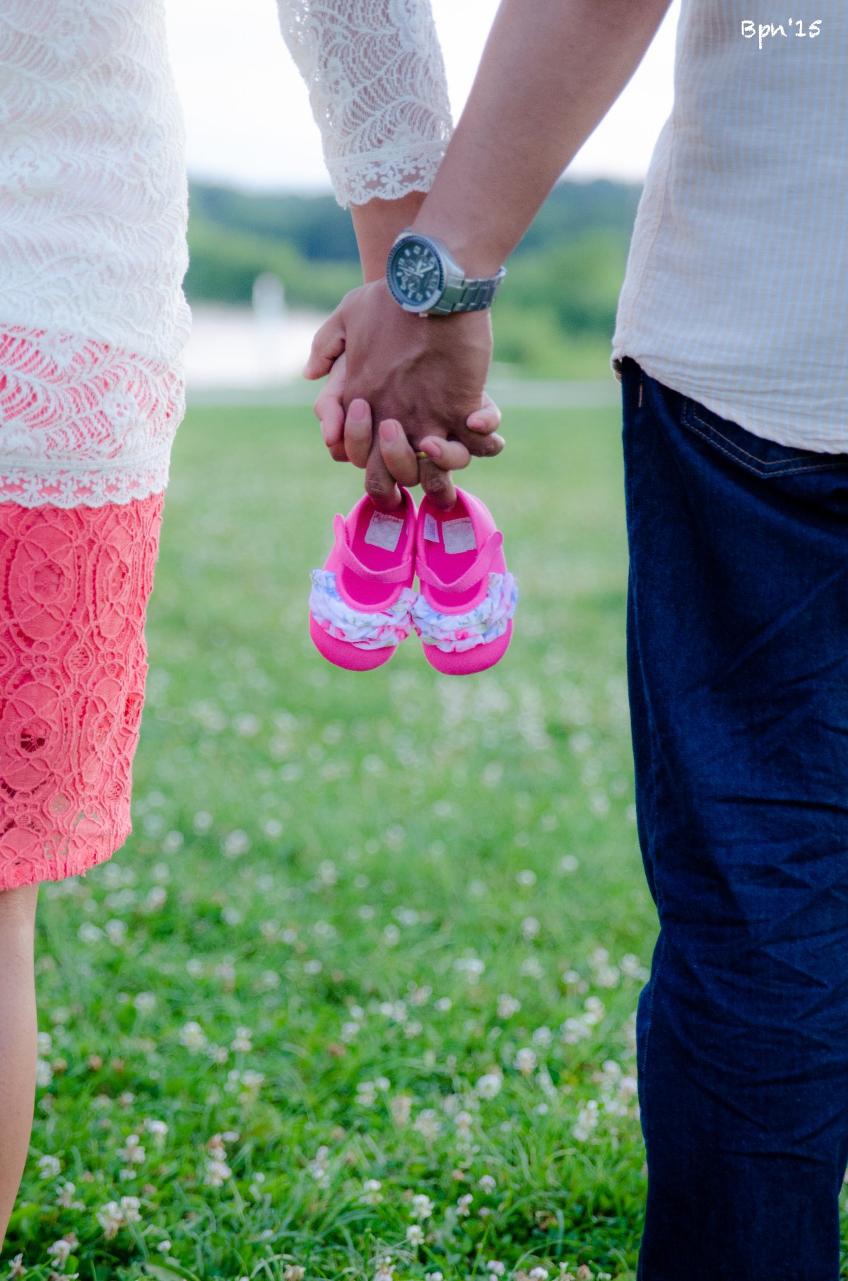Mom&Dad-to-be holding baby shoe