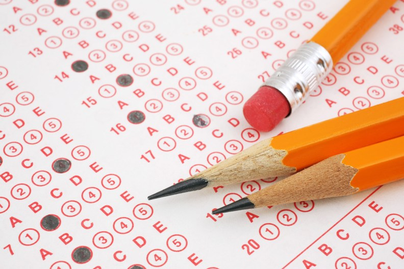 A photo of pencils laying on a partially filled out standardized test
