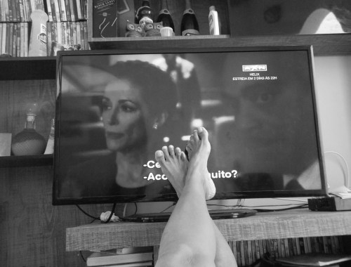 watching TV with the feet next to it