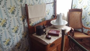 Table in Paul Dunbar room with bowl and pitcher. A docent on one visit told me the smaller pitcher to the left was used for mixing scented waters as a kind of after-shave treatment.