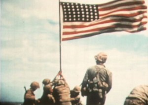 A still from motion picture film of the flag raising on Iwo Jima.