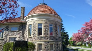 Exterior of part of Clyde's Public Library featuring names of famous artists, authors, and statesmen. (author's photo).