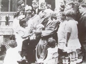 James Whitcomb Riley surrounded by school children.