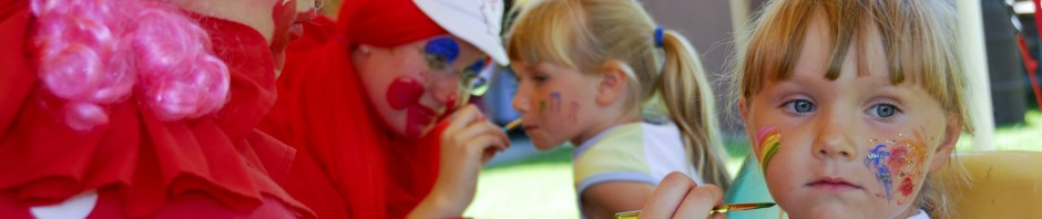 young girl having face painted for Canada Day