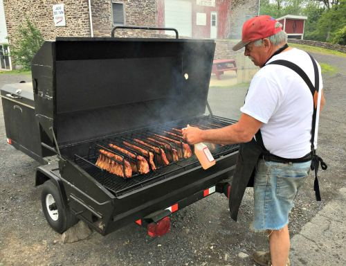 Jack Belli making ribs, Oink Johnson's BBQ; photo courtesy of Oink Johnson's BBQ