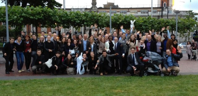 Members of Diamond Way Buddhism celebrate outside the Town Hall where Lambeth Council granted planning permission for the Beaufoy Institute
