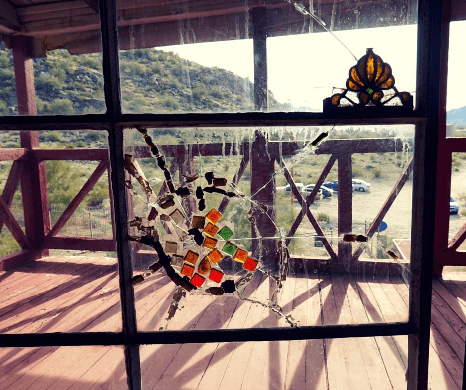 Broken window at Mystery Castle