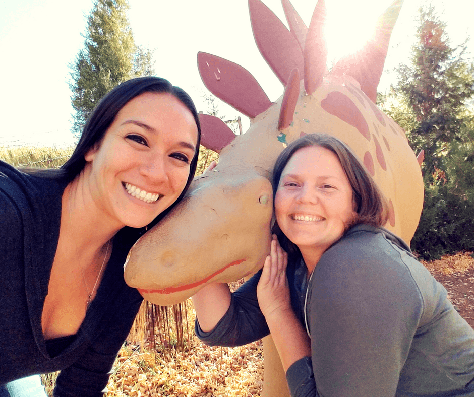 pictures with dinosaurs outside the visitor center of Dinosaur Ridge Colorado