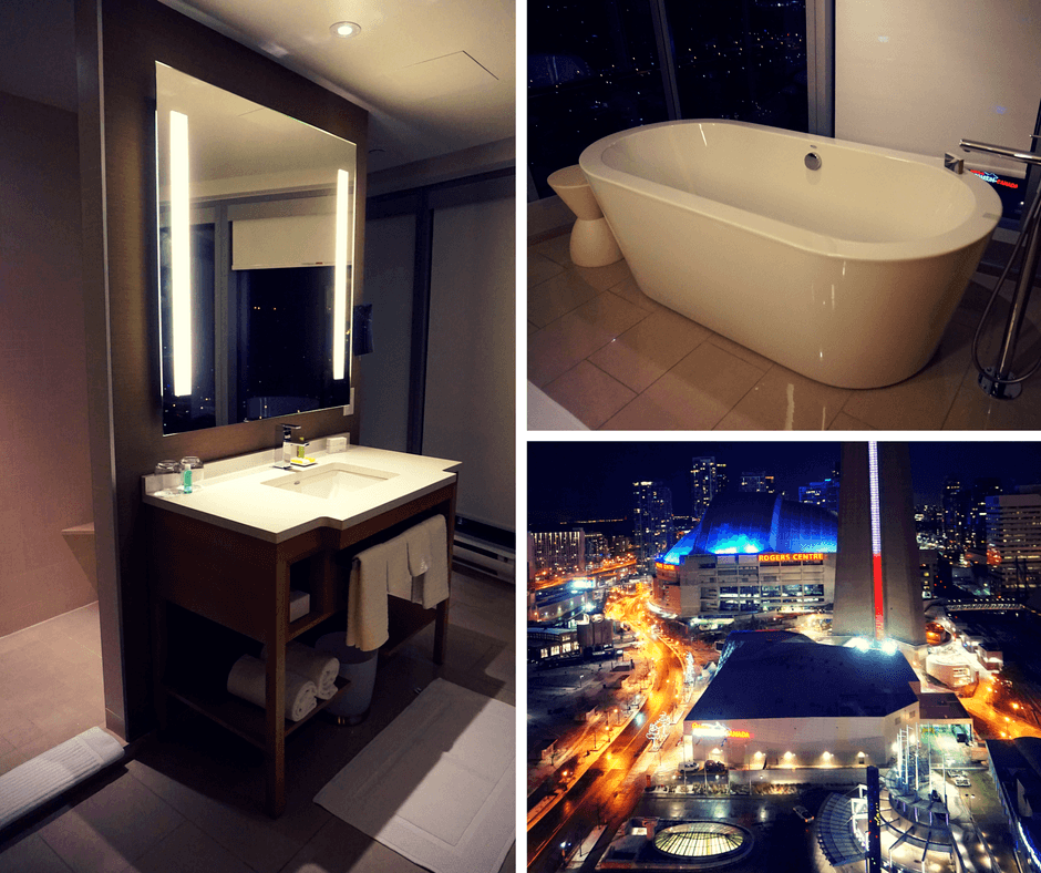 bathroom sink, bathtub, and view out of the window at the Delta Hotel Toronto