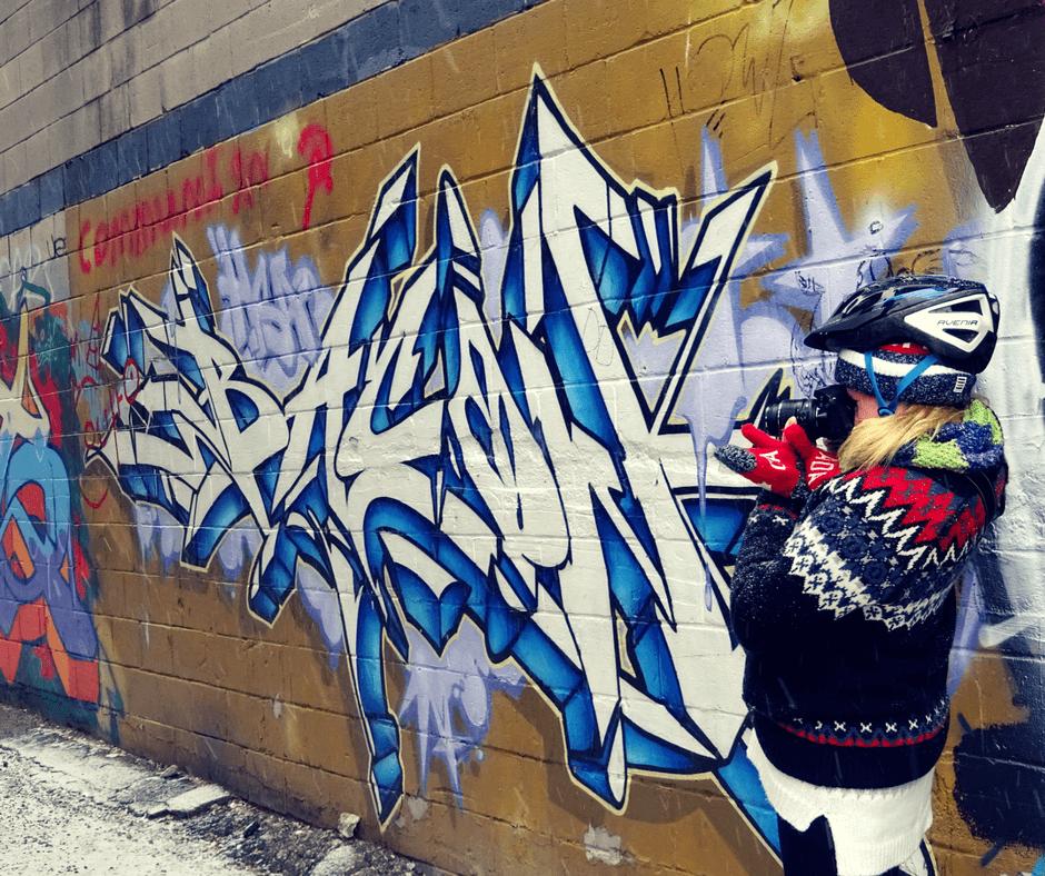 Taking photos in graffiti alley Toronto