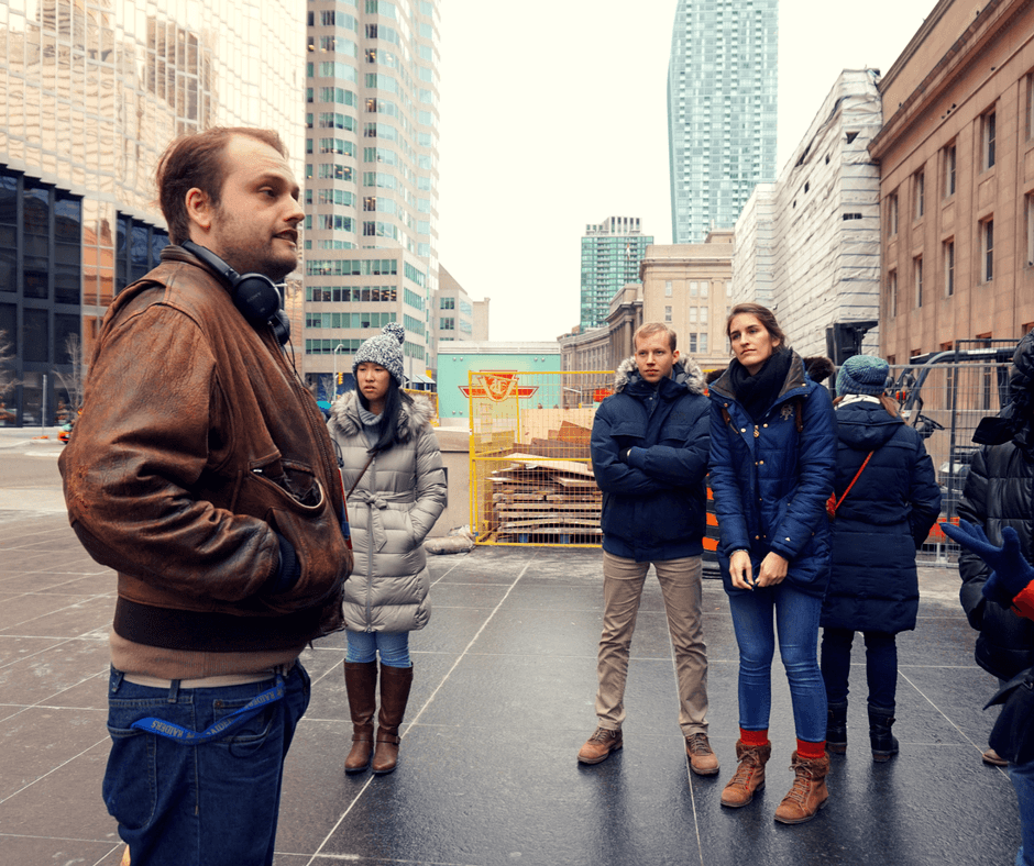 Our guide telling us about Toronto during our free Toronto walking tour