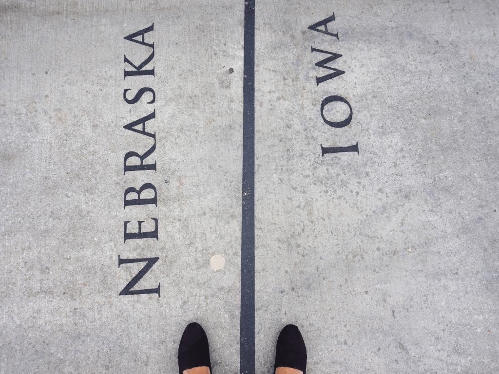One foot in Nebraska and one foot in Iowa on the Bob Kerrey Pedestrian Bridge