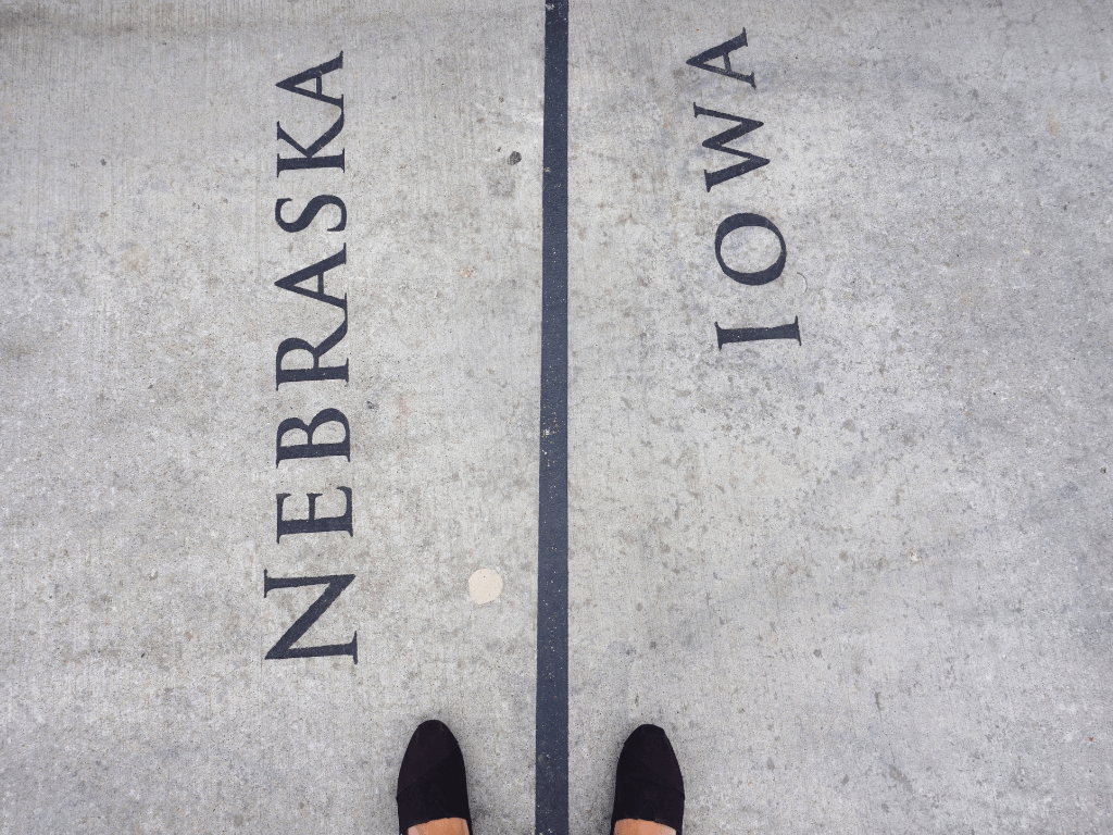 One foot in Nebraska and one foot in Iowa on the Bob Kerrey Pedestrian Bridge