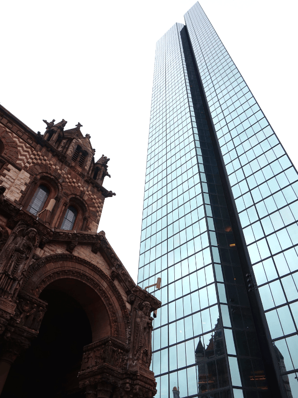 In complete contrast, the John Hancock Tower stands tall over the church