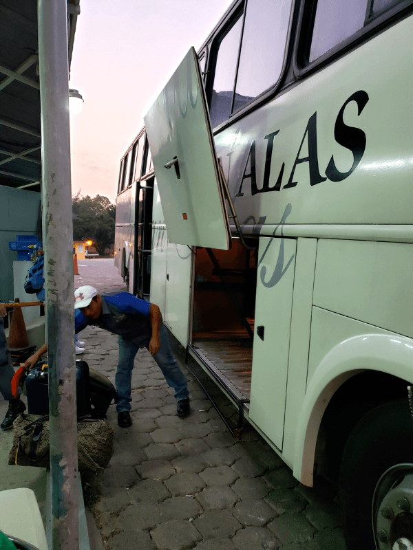 Luggage being loaded onto the Hedman Alas bus