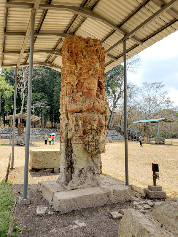 Sculpture with red paint in Copan Ruinas Honduras