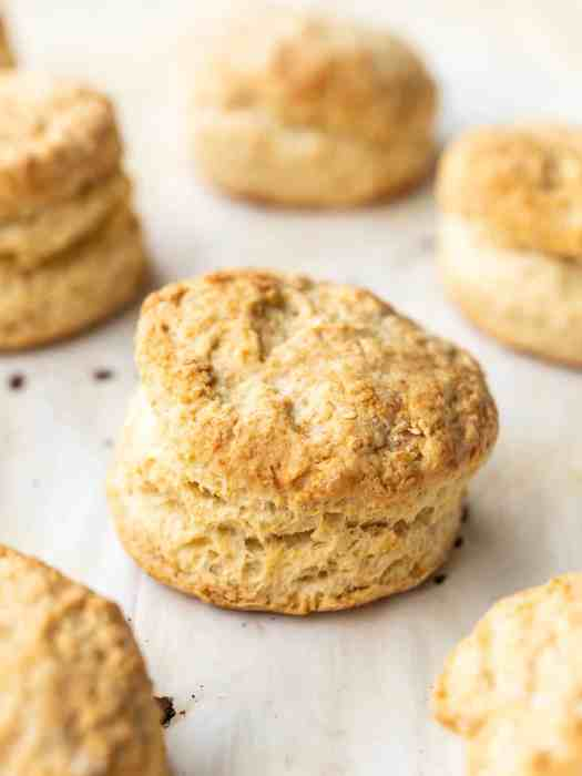 Side view of baked butter biscuits on a baking sheet close up