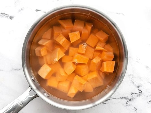 Diced sweet potato in a pot with water