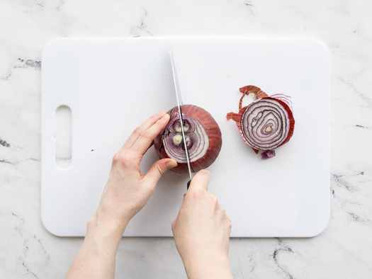 Onion being sliced in half