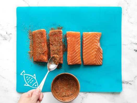 Season salmon filets