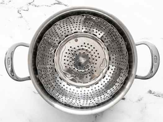 Steam basket in a pot with water