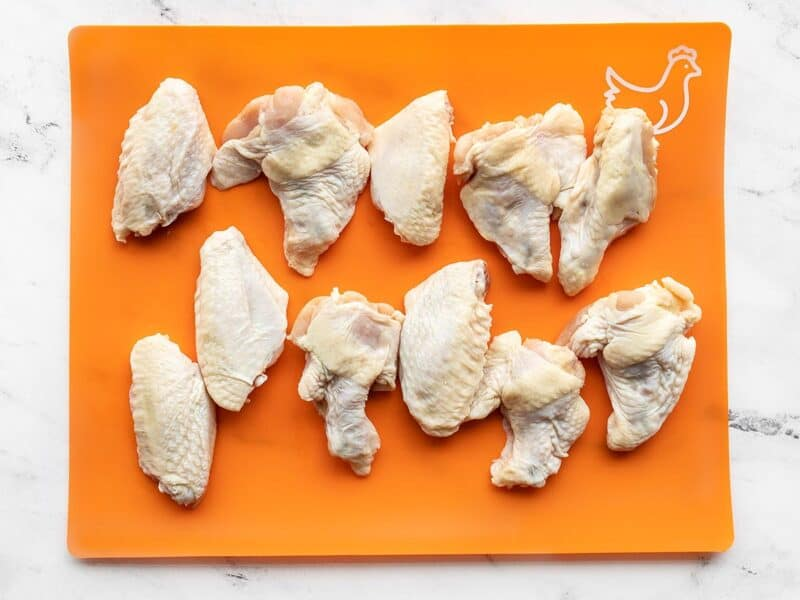 Raw chicken wings on a cutting board