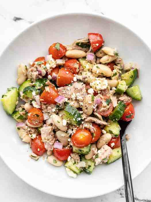 Overhead view of a bowl full of Mediterranean Tuna Salad with a fork in the side