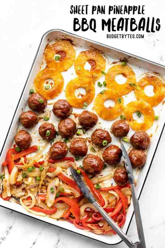 BBQ Meatballs, pineapple, peppers, and onions on a sheet pan with tongs, title text at the top