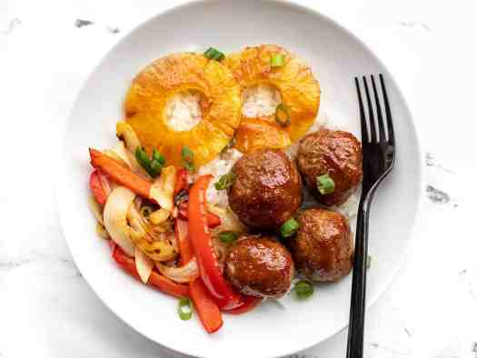 Sheet pan bbq meatballs in a bowl with pineapple, onions and peppers, and rice