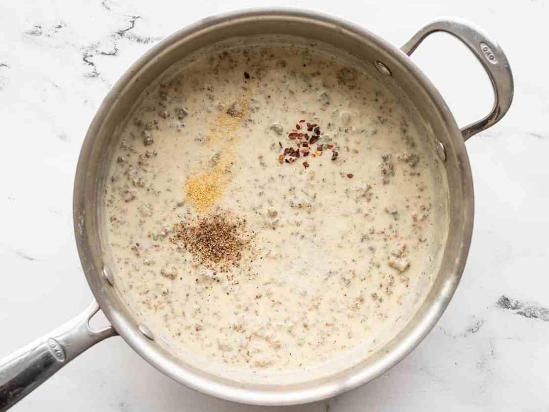 Seasonings added to gravy in the skillet