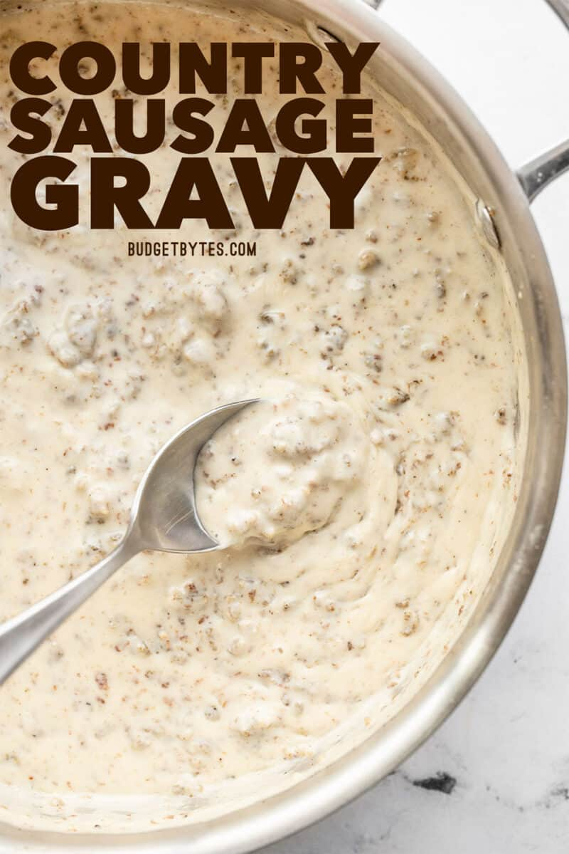 sausage gravy in a skillet with a spoon, title text at the top