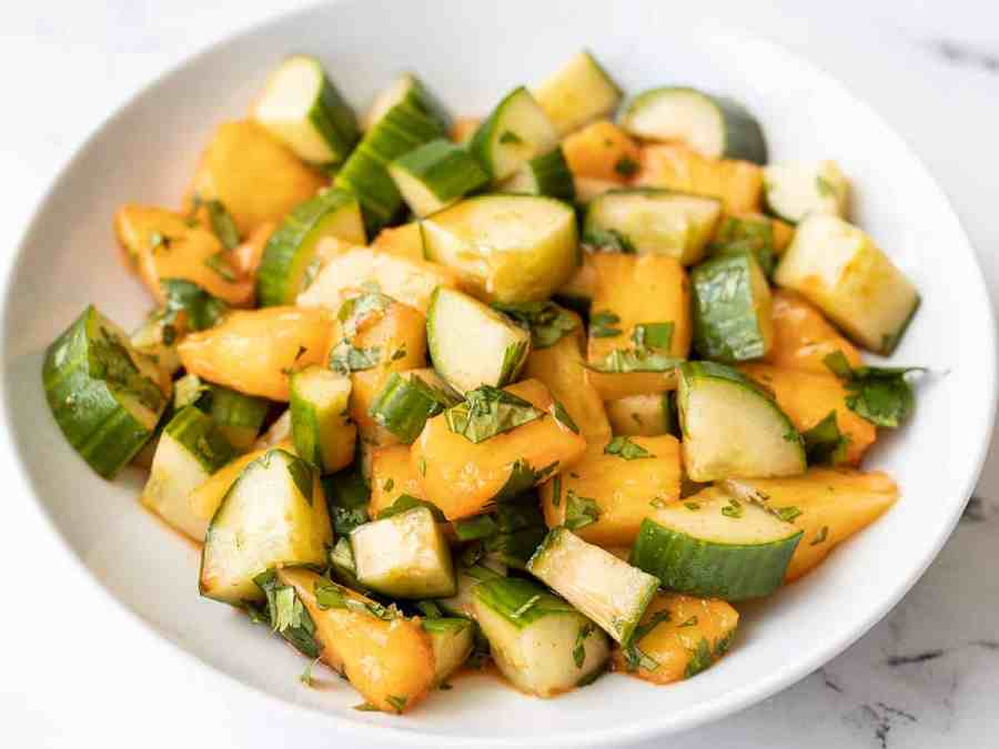 front view of a bowl full of spicy pineapple cucumber salad