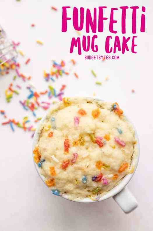 Overhead view of a funfetti mug cake, no frosting, title text at the top