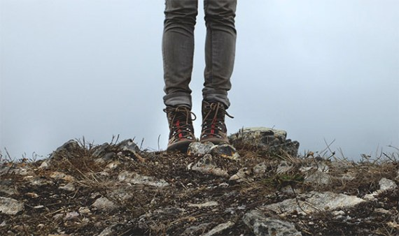 standing on mountain top