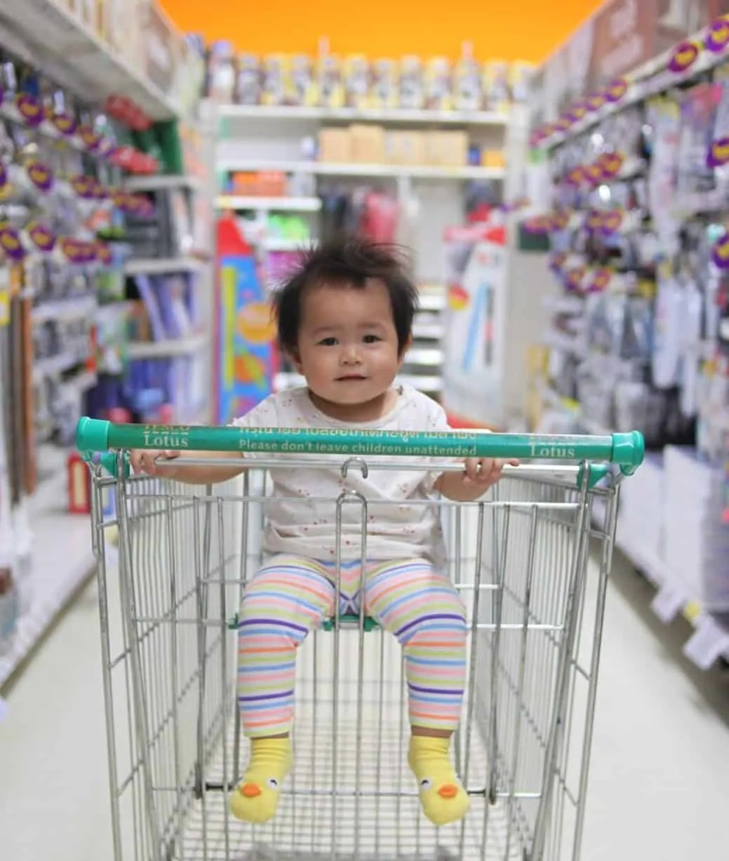 Baby in a shopping cart.