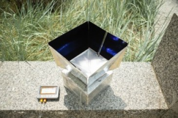 A radiative cooling device developed by UB researchers on top of a stone bench.