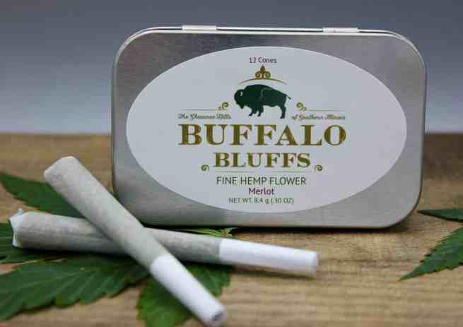 Large rectangular tin with two pre-rolled bluffs