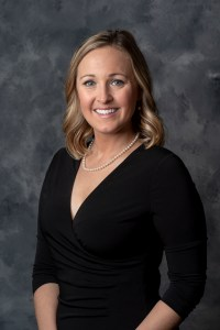 Board President Katie Morse standing in front of a gray background