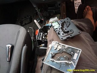 """The gear lever parts; Top left - surrounding trim, top right - bottom plate which house the """"Sport"""" & """"Winter"""" mode switch, bottom right - the chrome plate, bottom left - the gear knob. Middle - gear lever base"""