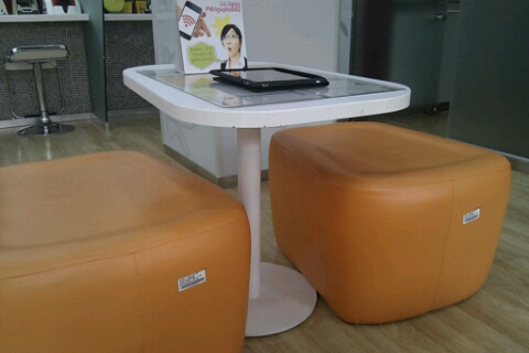 You'll find orange, green and yellow stools at this bank.
